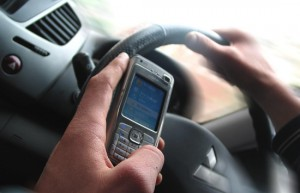 using a mobile phone in your hand while driving is an offence