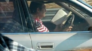 reading a book while driving